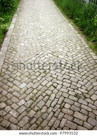 close up shot of a cobblestone alley - stock photo
