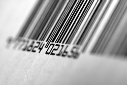 Close up shot of Barcode. Black and white. Focus on central numbers. Soft focus.