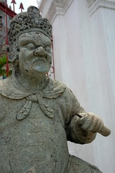 Close up traditional Chinese soldier statue in Bangkok temple of dawn.
