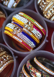 Close-up view of Indian woman jewelry bangles or bracelets in display of a retail shop