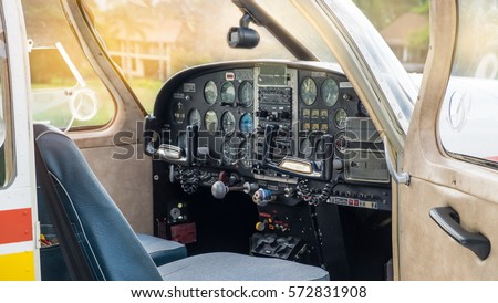Close-up view of small private aircraft cockpit. Jet pilots cabin. Steering wheel