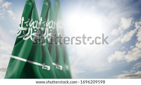 Close up waving flag of Saudi Arabia. National Saudi Arabia flag in the sky.