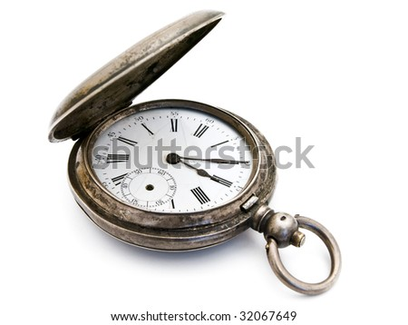 closed old silver pocket watch on a white background