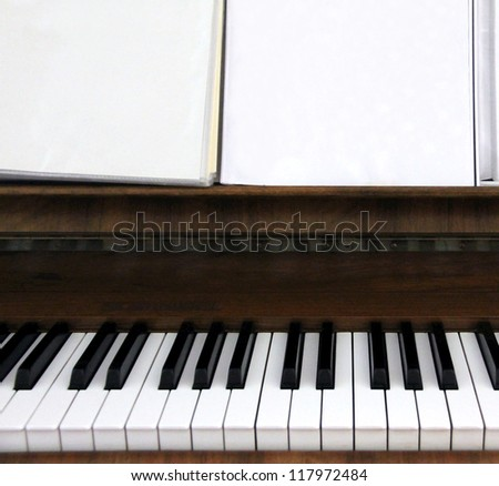 Closeup of a old piano keyboard