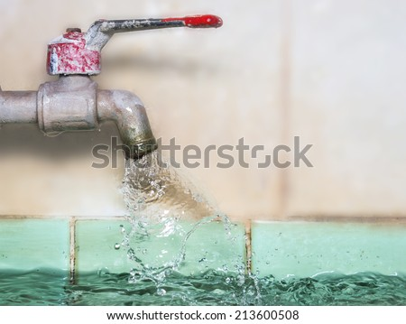 closeup Water leaking from old metal tap