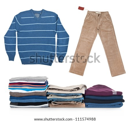 clothes collection with pants, sweater and stack of clothing