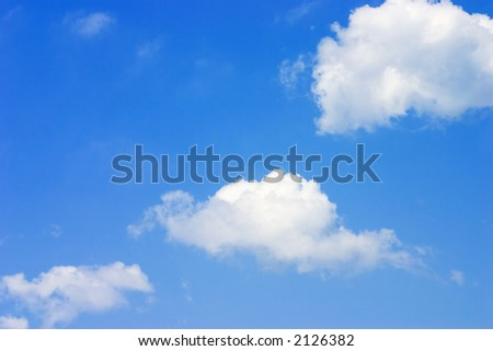 3 clouds on a bright blue sky
