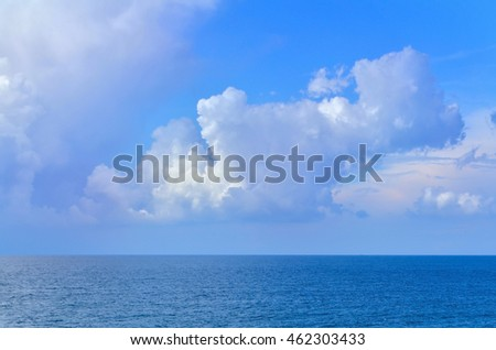 Cloudy sky over the sea during a bright day. #462303433