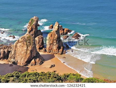 Coast of Portugal, cape Kabo-da-Roca. Picturesque, the freakish form of a rock on the bank of Atlantic ocean.