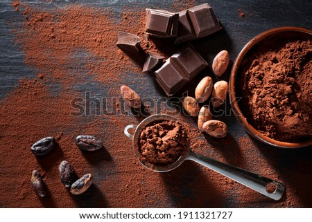 Cocoa beans, chocolate and cocoa powder still life