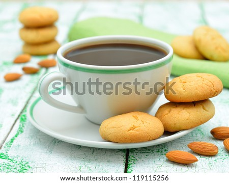 Coffee and almond cookies on a white table