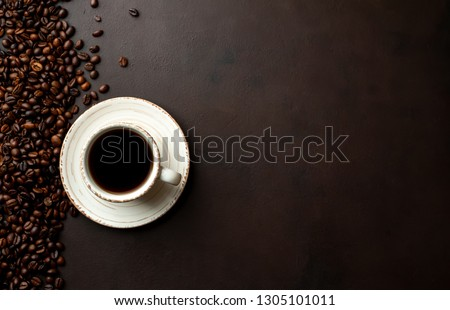 Coffee and beans on the old kitchen table. Top view with copyspace for your text.
