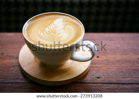 coffee latte / Cup of cappuccino. /hot milk art coffee on wooden table\ Photo in old image style.