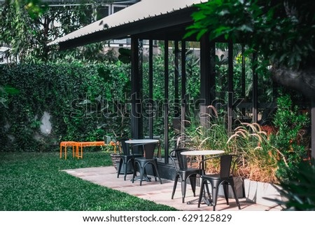 """"""" Coffee Shop """"  Outside view with vintage color tone  - Shutterstock ID 629125829"""