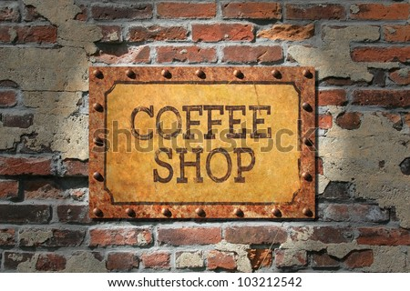 Coffee shop sign on rusted metal plate, rusted, riveted edges.That, on a very old brick wall./ Rusted Coffee Sign on 1890's Brick / Grunge for sure, good look for espresso bar, cafe, or coffee shop.