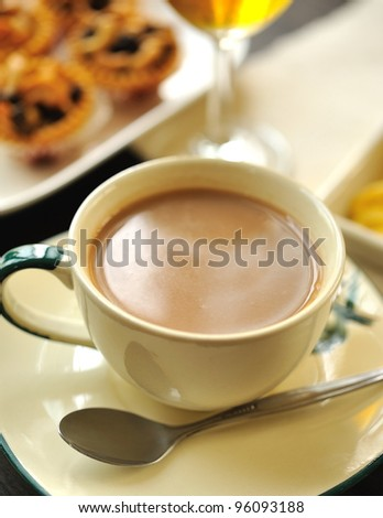 coffee with milk in cup with almond pies