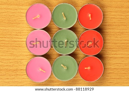 color candle are locate on wood ground