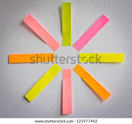8 colored blank sticky notes in shape of sun or flower for your text - business structure, diagram, goals etc.
