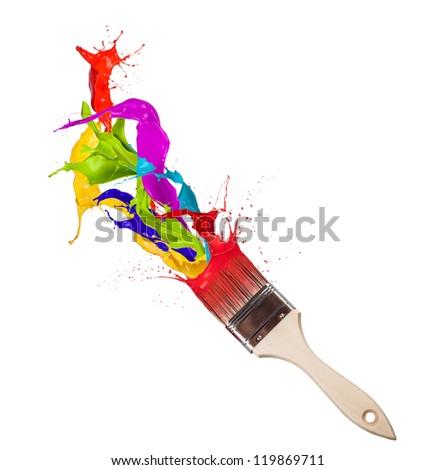 Colored paint splashes splashing from paintbrush on white background - stock photo