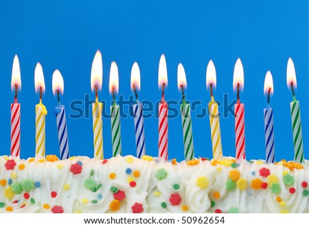 Colorful birthday candles on blue background