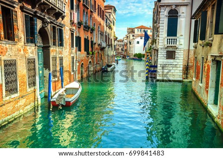 Colorful buildings and motorboats in the best touristic town, Venice, Veneto region, Italy, Europe #699841483
