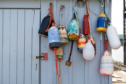 Colorful buoys hanging on an old shed in Nova Scotia, Canada.