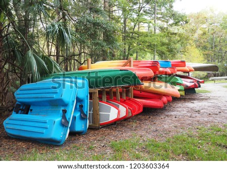 Colorful Canoes, Kayaks and Boats Waiting for an Adventure on a Florida Spring