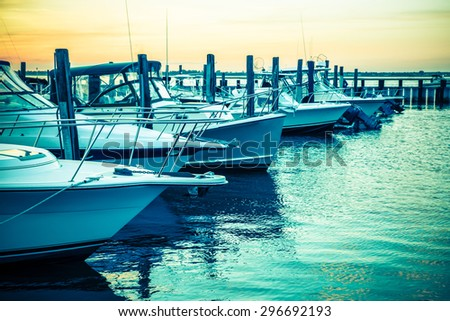 Colorful sunset toned boats docked at marina #296692193