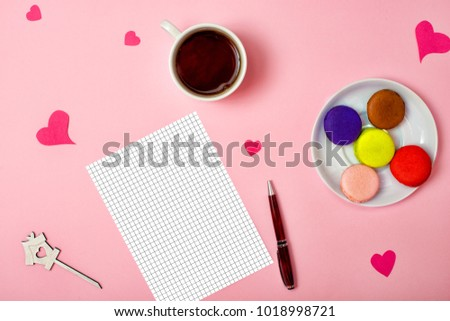 Colorful sweet macaroons and a cup of tea. Delicious breakfast.Sheet of paper for romantic stories. #1018998721