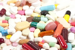 Colorful tablets with capsules on white