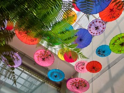 colorful umbrella decorations in the air