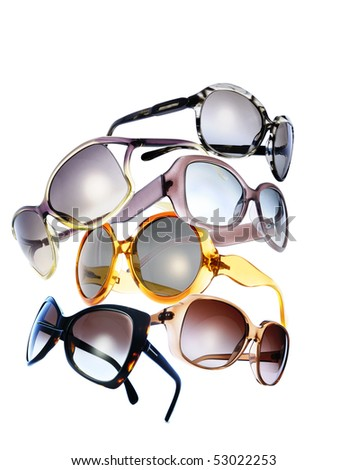 composition with very modern glamour sunglasses in white background