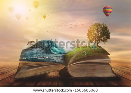 Photo of   Concept of an open magic book; open pages with water and land and small child. Fantasy, nature or learning concept, with copy space