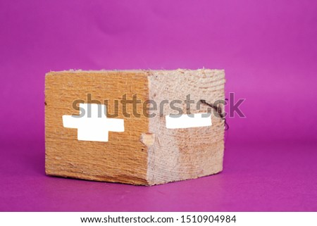 concept of opposites, big wood block with plus and minus on purple background #1510904984