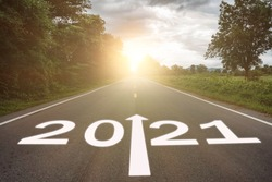 2021 concept. the growth up road sign in 2021 new year with road bacground, the direction way of 2021 to success