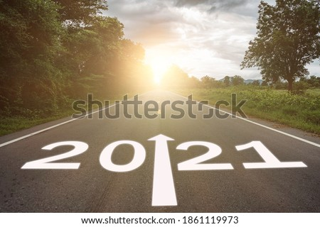 2021 concept. the growth up road sign in 2021 new year with road bacground, the direction way of 2021 to success Сток-фото ©