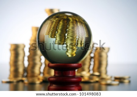 conceptual image  coin in the crystal ball