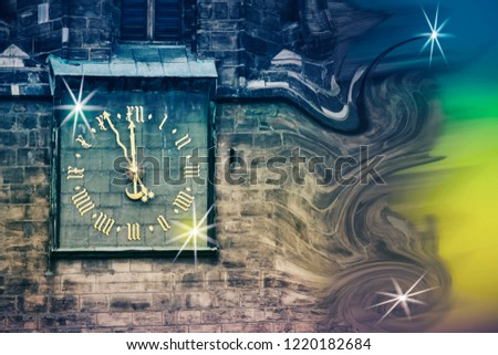 conceptual image of the outgoing and the arrival of the new year, the clock on the old tower shows five minutes to twelve
