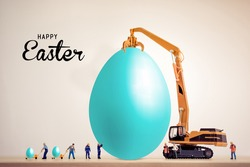 construction happy Easter. miniature worker people working on an egg, Easter holiday concept for business construction companies