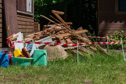 Construction site in an allotment garden. The coring of the arbor has started and the garbage is stored in front of the arbor