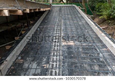 Construction work for ramp building concrete for the disabled.  Slope for walkway. #1030570378