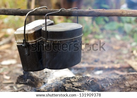 cooking pot over a campfire