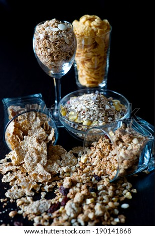 Corn flakes and granola  in glass