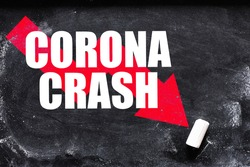 Corona Crash text on chalk board - concept in business. Declines in financial markets caused by the virus in 2020 around the world.