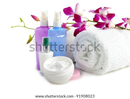 cosmetics  and towels with orchid on white background