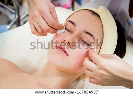 Cosmetologist apply cream to face of woman #167884937