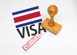 Costa Rica Visa Approved with Rubber Stamp and flag