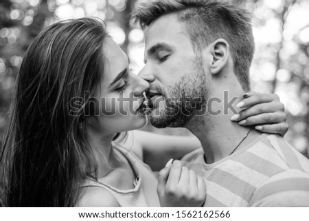 Couple in love kissing with passion outdoors. Man and woman attractive lovers romantic kiss. #1562162566