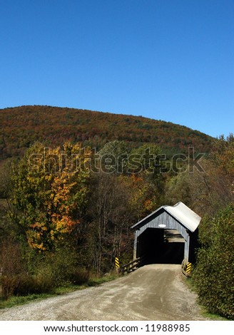 Covered bridge in autumn  in  province of Quebec