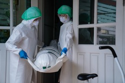 COVID-19 DEAD: Death increases every day. Staff wrapped up the dead bodies of Coronavirus covid-19 infection